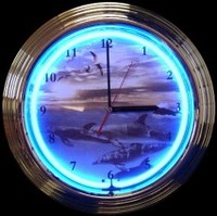 "Dolphins At Sea Neon Clock 14.5"" – Guaranteed bright and brilliant neon color! Quality neon clocks and neon wall clocks for less. Full 1-5 year no hassle warranty."