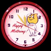 "Esso Happy Motoring Neon Clock 20"" – Guaranteed bright and brilliant neon color! Quality neon clocks and neon wall clocks for less. Full 1-5 year no hassle warranty."
